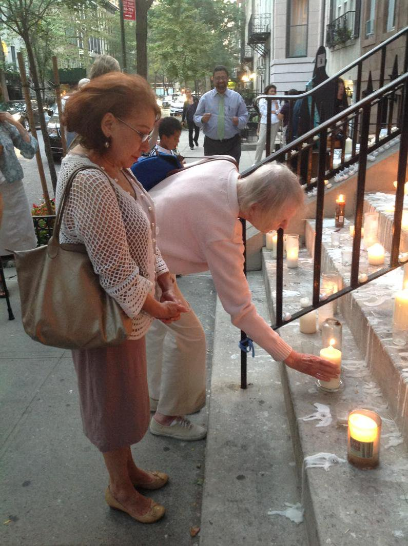 Mary Greason lights a candle - September 1, 2015